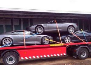 Шокирующее фото перевозки Aston Martin в автосалоны Польши